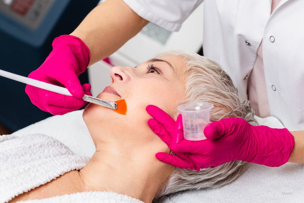 Woman getting a chemical peel.