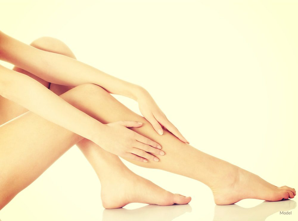 Women touching her smooth and healthy legs after skin cancer resconstruction.